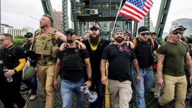 Proud Boys chairman Enrique Tarrio, holding a megaphone, with right-wing demonstrators in Portland, Oregon, in 2019.