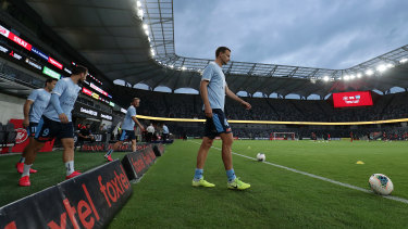Alex Wilkinson leads Sydney FC out onto Bankwest Stadium for a warm-up before what was probably their last game of the A-League season.