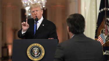President Donald Trump speaks to CNN White House correspondent Jim Acosta during the news conference.
