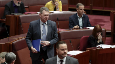 Nationals senator Steve Martin crosses the floor over a higher education bill on Monday.