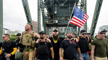 Members of the Proud Boys and other right-wing demonstrators march across the Hawthorne Bridge in Portland, Oregon, in August.