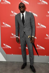 Usain Bolt at the Mumm champagne marquee.