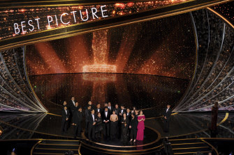 The cast and crew of Parasite accept the award for best picture at this year's Oscars.