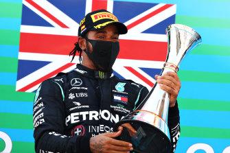 Mercedes driver Lewis Hamilton celebrates his Spanish Grand Prix win on Sunday.