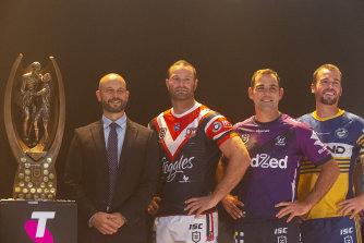 NRL chief Todd Greenberg at a captains' team photo with Boyd Cordner, Cameron Smith and Clint Gutherson at the NRL saeason launch in Sydney.