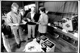 Brian Nebenzahl, with wife Jocelyn and printer Steve Popple, examines  catalogues in 1992.
