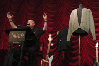 Auctioneer David Kruse during the sale of a cardigan worn by Kurt Cobain at an auction of rock memorabilia held at the Hard Rock Cafe, New York.
