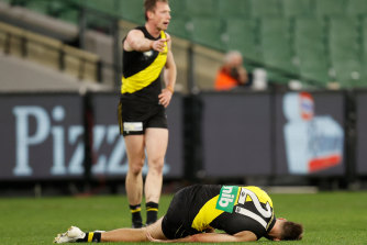 Noah Balta lays injured on the turf.