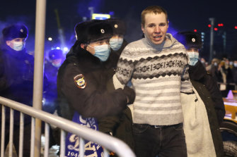 Police officers detain a man at Moscow's Vnukovo airport ahead of the scheduled arrival of Alexei Navalny.