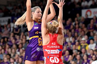 Gretel Bueta of the Queensland Firebirds in action against the NSW Swifts in round one.