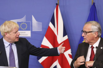 British PM Boris Johnson, left, gestures towards Jean-Claude Juncker, president of the European Commission.