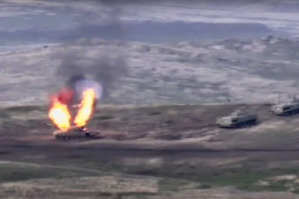 In this image taken from footage released by Armenian Defence Ministry, Armenian forces destroy an Azerbaijani tank at the contact line of the self-proclaimed Republic of Nagorno-Karabakh.