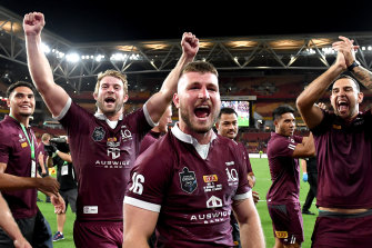 Good times: Queensland politicians  up in the corporate boxes enjoyed the Maroons' win as much as the players.