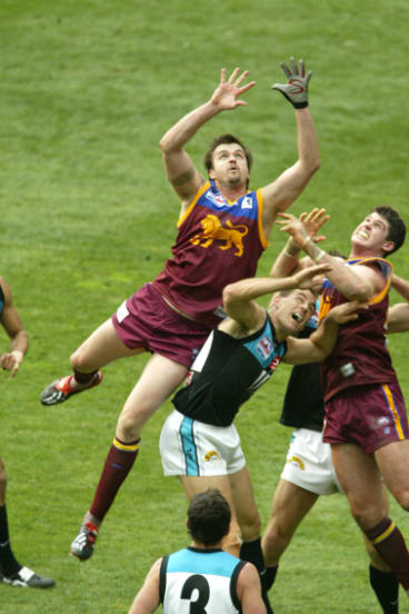 Clark Keating (L) flies for a mark in the 2004 grand final.