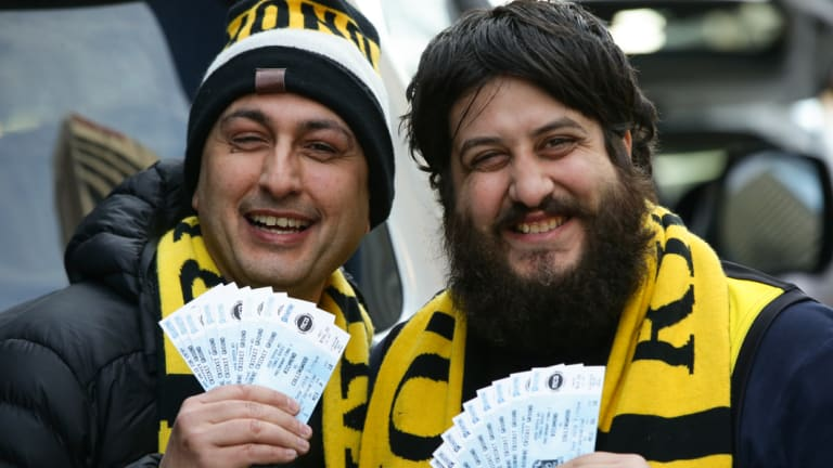 Dino Krommydas and Dennis Jim Moschoyiannis with their tickets.
