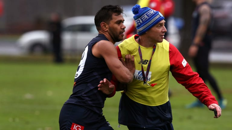 Competitive: Neville Jetta goes up against Melbourne coach Simon Goodwin in training.