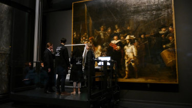 Technicians and researchers check equipment set up inside a glass chamber as they begin to study Rembrandt's 'Night Watch' masterpiece, at the Rijksmuseum in Amsterdam on Monday.