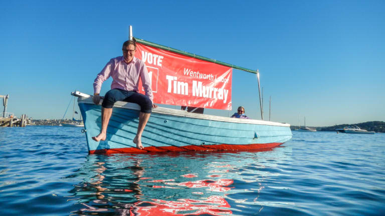 Labor candidate Tim Murray, with his uncle John Murray's boat.