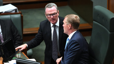 Leader of the House Christopher Pyne confers with Speaker Tony Smith on Tuesday.