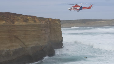 A helicopter carries out the rescue operation.