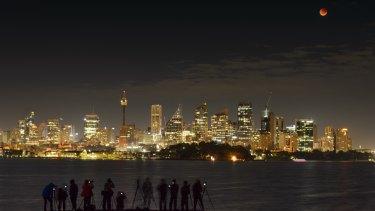 Photographers capture the blood moon over Sydney's skyline.