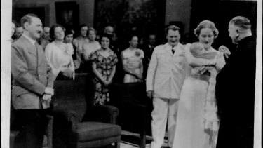 Goering's daughter Edda christened - Hitler as a proud godfather looks on, 1938.