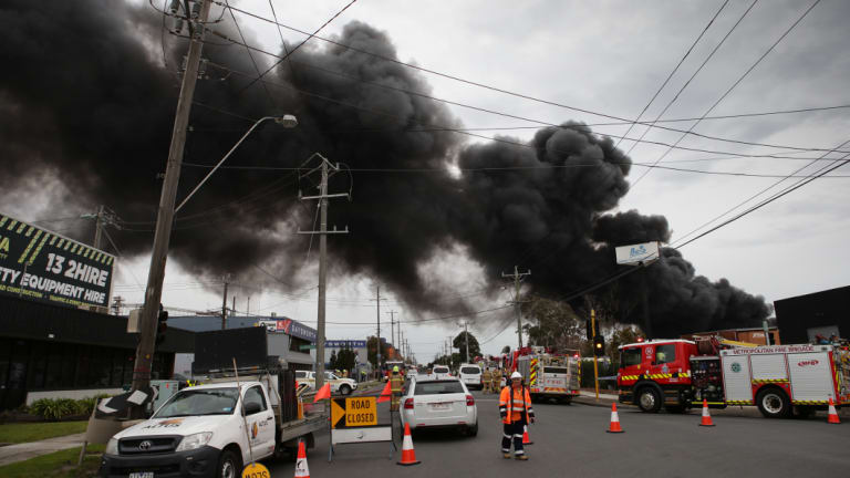 Black smoke poured out of the burning factory throughout Thursday.