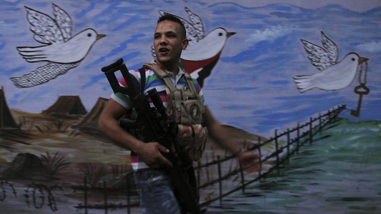Fatah soldier Abu Raban patrols the streets of the Fatah area of Ain al-Hilweh, the Palestinian camp in Sidon, Lebanon.