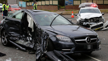 Police car involved in crash was looking for driver on mobile phone