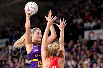 Gretel Bueta of the Firebirds in action against the NSW Swifts in round one.