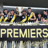 The Tigers pose with the premiership cup.