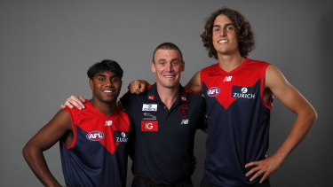 New Demons: Melbourne coach Simon Goodwin with draftees Luke Jackson (right) and Kozzie Pickett.