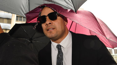 A supporter of Jarryd Hayne has been fined for spitting on the ground outside a Newcastle court.