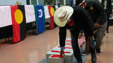 Yawuru law boss Neil McKenzie leads a remains repatriation ceremony at the Australian embassy in Berlin on Monday.