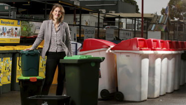 Yarra Council mayor Danae Bosler with some of the recycling bins.