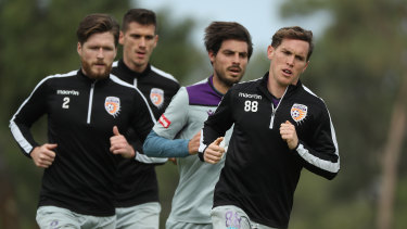Neil Kilkenny leads Alex Grant, Bruno Fornaroli and Tomislav Mrcela while running during a Perth Glory A-League training session at UWA Sports Park.