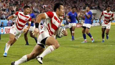 Japan's Kenki Fukuoka runs in to score against Samoa.