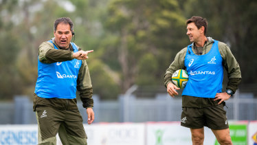 Wallabies coach Dave Rennie and assistant Scott Wisemantel watch on at training in the Hunter Valley on Tuesday.