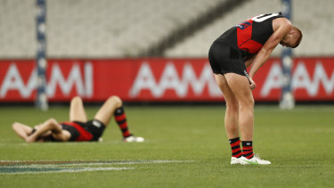 Dejected Essendon players after the final siren of the game against the Swans at the MCG.