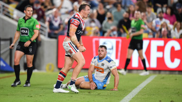 Not done yet ... Sydney Roosters centre Josh Morris celebrates a try against the Gold Coast Titans last week.