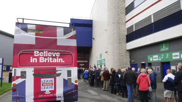 Brexiters queued beside a new Brexit 'battle bus' in Bolton.