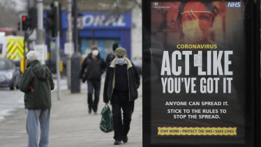 A sign at a bus stop in West Ealing in London reminds passersby to beware of spreading the virus.