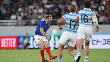 Sealing the deal: Camille Lopez kicks the winning drop goal for France against the Pumas.