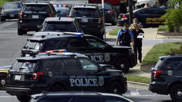 Police surround the Capital Gazette building after the shooting.