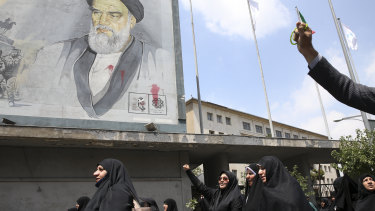 Under a portrait of the late Iranian revolutionary founder Ayatollah Khomeini, worshippers chant slogans in a pro-Palestinian rally in Tehran.