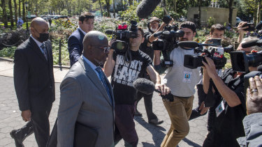Deveraux Cannick, lawyer for R. Kelly, is surrounded by the media during a break at the Brooklyn Federal Court House in New York.