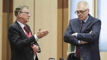 Professor Peter Collignon and Adjunct Professor Bill Bowtell at a Senate select committee hearing on the coronavirus in Canberra last month.