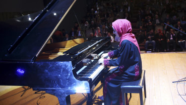 Palestinian pianist Yara Thabit plays the restored piano.