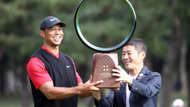 Tiger Woods prevailed in the first PGA Tour event staged in Japan.