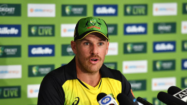 Aaron Finch fronts the media.